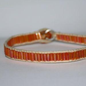 Beautiful summer orange and tan glass bracelet